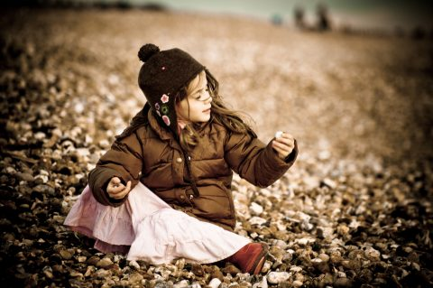 Hampshire and Dorset Lifestyle photographer - girl playing on each at Milford-on-sea - Sillick photography