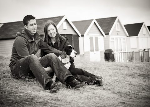 Lifestyle portrait of couple sitting on beach at Mudeford Spit - Hampshire and Dorset photographer - Sillick photography