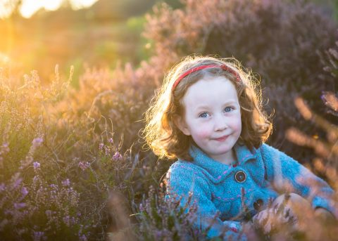 Hampshire and Dorset lifestyle portrait photography - Girl sitting in New Forest heather at sunset - Sillick Photography