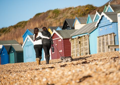 Hampshire and Dorset portrait photography - Sillick Photography - girls walking on Barton beach