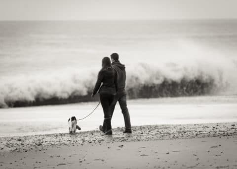 Hampshire and Dorset lifestyle photography - couple walking on beach - Sillick Photography