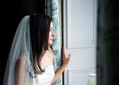 Hampshire and Dorset wedding photographer - Sillick Photography - Hill Place, Swanmore - Bride looking out of window
