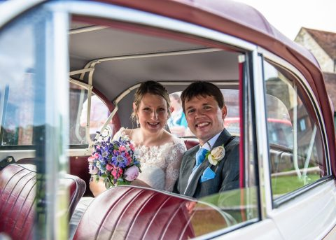 Surrey wedding photographer - Couple in car at the Walled Gardens, Cowdray - Sillick Photography